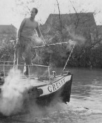 Tom Rolt steers the narrow boat 'Cressy'